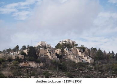 Jerusalem, Israel - December 24 2017: Houses on the hill in Shuafat in East Jerusalem. The neighbourhood is famous for a refugee camp in the town.