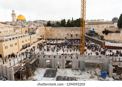 Jerusalem, Israel - December 24th, 2018: Expanded view of Western Wall or Wailing Wall - the most religious site in the world for Jewish people, construction work in the Old City of Jerusalem, Israel.