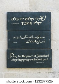 Jerusalem / Israel - December 25 2015: Inscription on wall in Jerusalem, 25 December 2015, in Hebrew, Arabic and English language: Pray for the peace for Jerusalem! may they prosper who love you!
