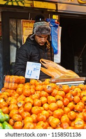 JERUSALEM, ISRAEL - DECEMBER 26, 2016:  persimmons is on the counter in the market of Mahane Yehuda in Jerusalem. More than 250 marketers sell fruits, vegetables, baked products, fish, meat and others