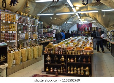 JERUSALEM, ISRAEL - DECEMBER 26, 2016:  Tourist buy spices in small shop in the old city Jerusalem, Israel