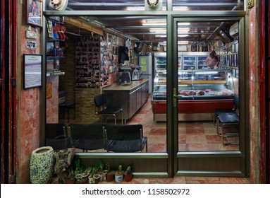 JERUSALEM, ISRAEL - DECEMBER 26, 2016: Arab women are sitting in butcher's shop at the market in the old city of Jerusalem, Israel