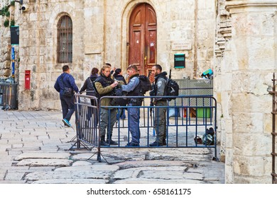 JERUSALEM, ISRAEL - DECEMBER 26, 2016:  police officers are taking care of the security in the old city of Jerusalem on the via Dolorosa, the way Jesus walked with his cross