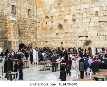 Jerusalem, Israel - December 28, 2017:  Jewish worshipers pray at the Wailing Wall, friday evening starting Shabbat in the sunset, Old City of Jerusalem.