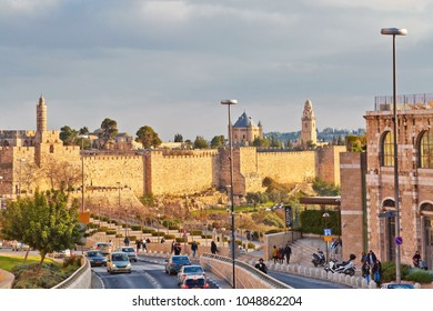 JERUSALEM, ISRAEL - DECEMBER 29, 2016: A road traffic along the wall of the old city of Jerusalem near the Jaffa gate