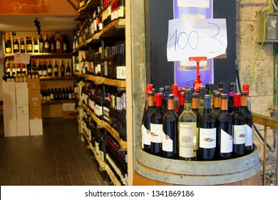 JERUSALEM, ISRAEL - February 14, 2019. Front view and inside view of a liquor store selling bottles of red and white Israeli and international wine at the Mahane (Machane) Yehuda market.