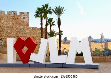 JERUSALEM, ISRAEL - February 14, 2019. Sculpture of 'I Love JLM' and palm trees at the entrance of the old city.