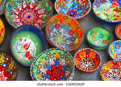 JERUSALEM, ISRAEL - February 14, 2019. Display of colorful ceramic dinner set in market store in the old city.