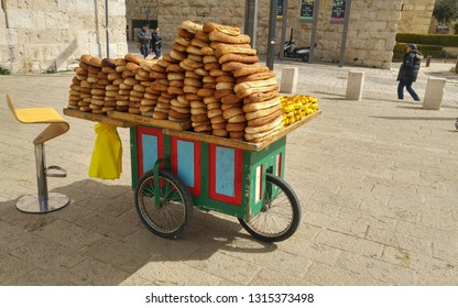 JERUSALEM, ISRAEL. February 15, 2019. Baker's cart with white baegeleh bread by the Jaffa gate of the Old city Jerusalem.