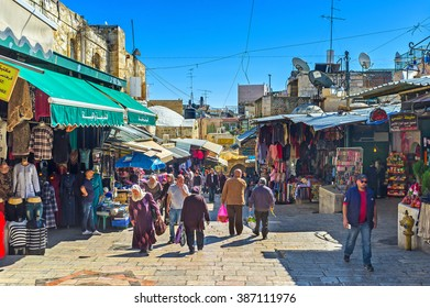 JERUSALEM, ISRAEL - FEBRUARY 16, 2016: The crowded Arab Souq at Damascus Gate is one of the noisiest and most interesting locations in the walled city, on February 16 in Jerusalem.