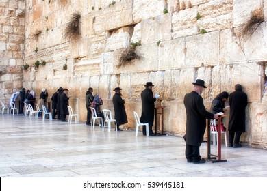 Jerusalem, Israel - February 17, 2012: Men Praying at the sacred Wailing Wall.