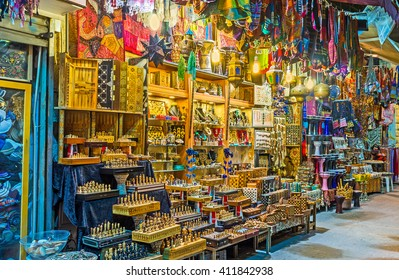 JERUSALEM, ISRAEL - FEBRUARY 17, 2016: The bright illuminated stall with many different handmade souvenirs, on February 17 in Jerusalem.