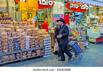JERUSALEM, ISRAEL - FEBRUARY 17, 2016: The cookies and  marshmallows in blister packs attracts the clients in Mahane Yehuda market, on February 17 in Jerusalem.