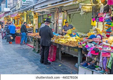 JERUSALEM, ISRAEL - FEBRUARY 17, 2016: Evening in Mahane Yehuda market - the best place to enjoy Middle Eastern trading traditions and taste various types of local food, on February 17 in Jerusalem.