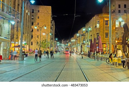 JERUSALEM, ISRAEL - FEBRUARY 17, 2016: The evening makes the Jaffa Road best place to spend the time in cozy outdoor cafe or restaurant of local cuisine, on February 17 in Jerusalem.