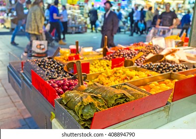 JERUSALEM, ISRAEL - FEBRUARY 18, 2016: The Mahane Yehuda market offers various marinated olives, canned grape leaves, pickled peppers and other local cuisines, on February 18 in Jerusalem.