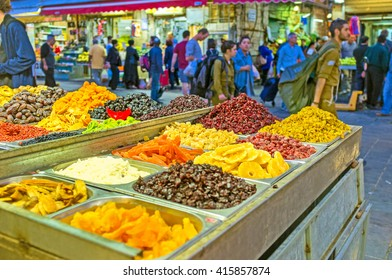 JERUSALEM, ISRAEL - FEBRUARY 18, 2016: The stall in Mahane Yehuda market offers different dried fruits on each taste, on February 18 in Jerusalem.