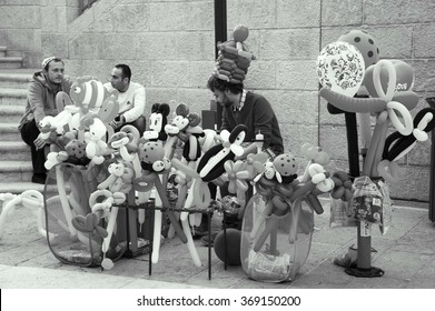 JERUSALEM, ISRAEL - FEBRUARY 19, 2014: Balloon twister specializing in in entertaining events promoting himself at Mamilla pedestrian promenade.