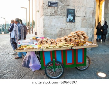 JERUSALEM, ISRAEL - FEBRUARY 19, 2014: Typical Jerusalem bagel bread, falaefel and pastries for sale near Jaffa gate in Old City.