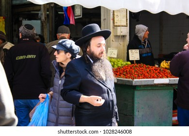 Jerusalem Israel February 19-2018 Unknowns people shopping at the Mahane Yehuda Market in Jerusalem on the morning