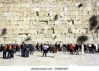 Jerusalem, Israel - February 22, 2012: Jews praying at the Western Wall, an ancient retaining wall of the old Jewish Temple that used to stand on the Temple Mount in Jerusalem.
