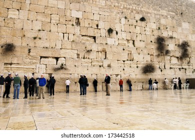 JERUSALEM, ISRAEL - FEBRUARY 25, 2010: Unidentified people praying in front of the Wailing Wall.