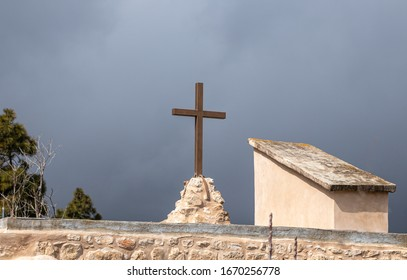 Jerusalem, Israel, February 29, 2020 : The large metal cross on the roof of the abandoned Greek Orthodox Church at the end of the street in the old district of Jerusalem city in Israel