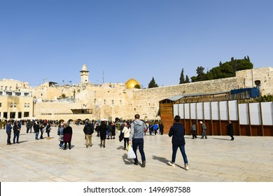 Jerusalem, Israel, January 13, 2019. Tourists and religious people visit and pray in the square of the Western Wall. Western Wall is an ancient limestone wall in the Old City of Jerusalem, Israel.