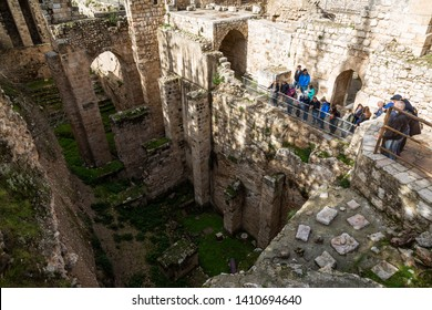 Jerusalem, Israel - January 17 2018: Tourists look down at the ruins of the Pool of Bethesda.