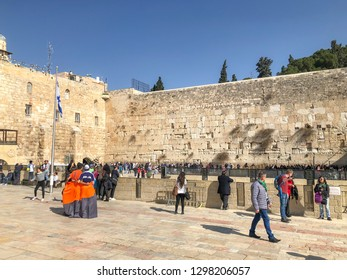 JERUSALEM, ISRAEL - JANUARY 22, 2019: Jewish worshipers pray at the Wailing Wall. The Western Wall, Wailing Wall or Kotel is located in the Old City of Jerusalem