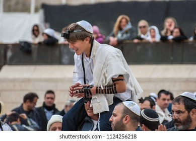 JERUSALEM, ISRAEL - JANUARY 26, 2012: A 13 years old jewish boy and his relatives during celebrate Bar Mitzvah ceremony at Western Wall in Jerusalem