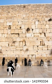 JERUSALEM, ISRAEL - JANUARY 26: Jewish worshipers pray at the Wailing Wall. The most holy site for Jews. January 26, 2011 in Jerusalem, Israel.