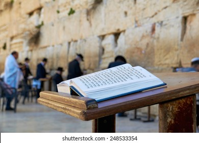 Jerusalem, Israel - January 30, 2015: Western Wall also known as Wailing Wall or Kotel. The Torah Book in the foreground.