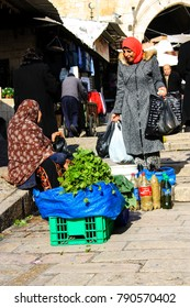 Jerusalem Israel January 7-2018 Unknown people selling vegetables in the Muslim quarter of the old city of Jerusalem