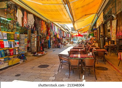 JERUSALEM, ISRAEL - JULY 10, 2014: Market in Muristan - complex of streets, shops and restaurants in Christian quarter of Old City. It is very popular with tourists and pilgrims visiting Holy Land.