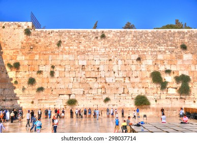 JERUSALEM, ISRAEL, July 13: HDR (high dynamic range) image - People visiting and praying at the Western Wall in a clear blue sky. July 13, 2015 in Jerusalem, Israel