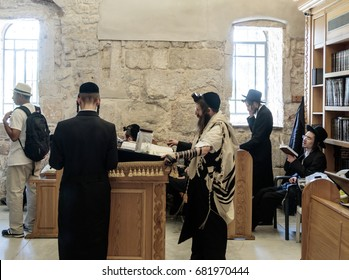Jerusalem, Israel, July 14, 2017 : Religious Jewish men read prayers in the Tomb of King David in the old city of Jerusalem, Israel