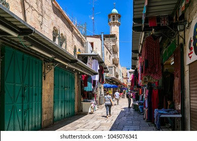 JERUSALEM, ISRAEL - JULY 16, 2017: Narrow street among small shops of famous bazaar - market in Old City of Jerusalem, very popular destination with locals, tourists and pilgrims visiting Israel.