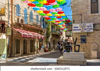 JERUSALEM, ISRAEL - JULY 16, 2017: Multicolored parasols above narrow pedestrian street of Yoel Moshe Salomon in historic Nachalat Shiva district of Jerusalem as part of Umbrellas Street Project.