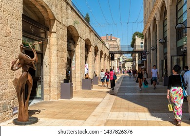 JERUSALEM, ISRAEL - JULY 16, 2017: People walking among shops, boutiques and art sculptures at open air Mamilla mall - shopping street with 610 m pedestrian promenade called Alrov Mamilla Avenue.
