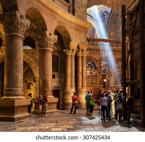 JERUSALEM, ISRAEL - JULY 26, 2015: People inside Church of the Holy Sepulchre - place where according christian tradition Jesus Christ was crucified, buried and resurrected.