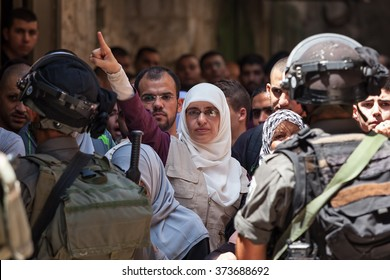 JERUSALEM, ISRAEL - JULY 26, 2015: Palestinian protest against ascent of jews to Temple Mount during Tisha B'Av - annual fast day in Judaism commemorates destruction of First and Second Temples.