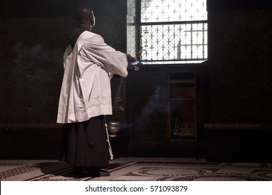 Jerusalem, Israel - July 6, 2014: Franciscan monk meditate pray in the Chapel of the Nails of the Cross in the Church of Holy Sepulchre during via Dolorosa precession.