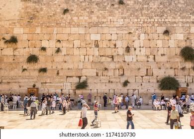 JERUSALEM, ISRAEL - JULY 7, 2014: Jewish worshipers during morning prayers at the Wailing Wall, Jerusalem, Israel