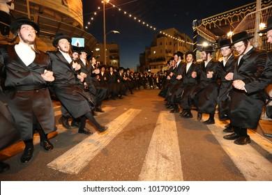 JERUSALEM, ISRAEL - JUN 7, 2017: Unidentified Jewish men dance in the streets of Jerusalem during the wedding of the granddaughter of the Grand Rabbi of Belz