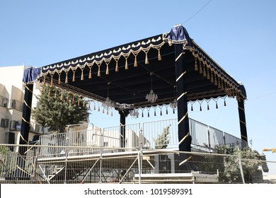 "JERUSALEM, ISRAEL - JUN 7, 2017: Jewish wedding canopy known as ""Chuppah"" erected on a Jerusalem, Israel street in the summer for a grand wedding"
