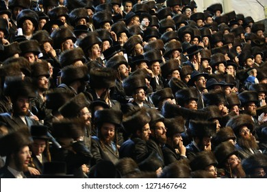 JERUSALEM, ISRAEL - JUN 7, 2017; Thousands of ultra orthodox hasidic Jews attend and sit in the bleachers at the grand wedding of the Belzer Rebbe's granddaughter