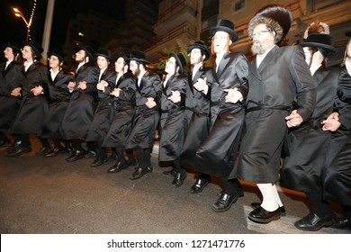JERUSALEM, ISRAEL - JUN 7, 2017: Unidentified Jewish men dance in the streets of Jerusalem during the wedding of the granddaughter of the Grand Rabbi of Belz