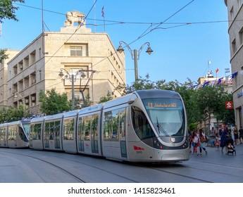 "Jerusalem / Israel - June 04 2019: Jerusalem tram on Jaffa street in Jerusalem, against the background of the ""Generali"" building."
