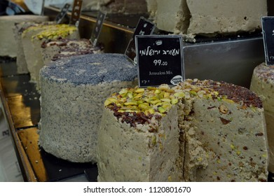 Jerusalem, Israel - June 12. Halva (Oriental Sweets) with different flavors and fillings on Mahane Yehuda market in Selective focus. Halva (halawa, helwa, halvah, halava) assortment with prices.